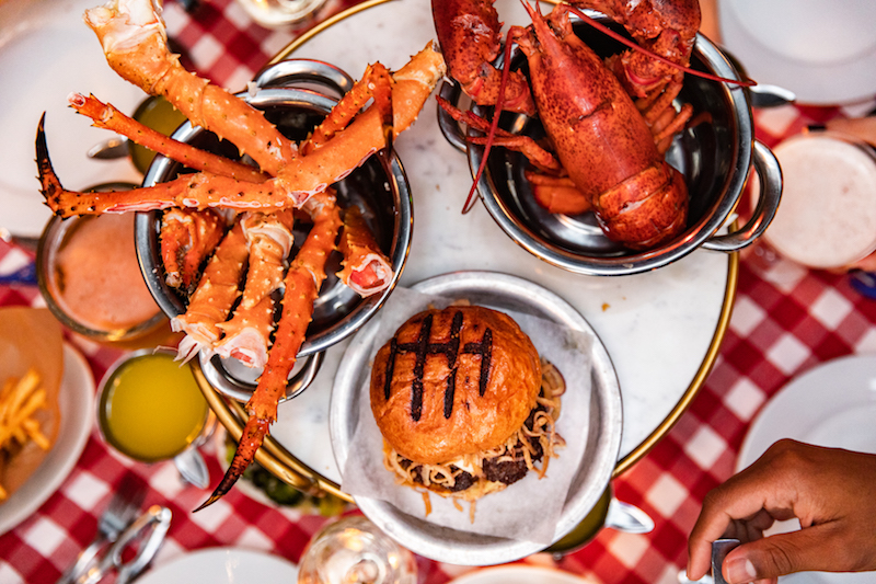 image of spinning susan with burger, lobster, and crab claws on top